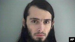 FILE - Court documents say Christopher Lee Cornell, shown in this Jan. 14, 2015 Butler County (Ohio) Jail photo, intended to set off pipe bombs outside the U.S. Capitol.