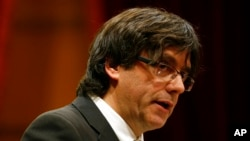 FILE - Incoming Catalan President Carles Puigdemont speaks during the investiture session at the Catalonian parliament in Barcelona, Spain, Jan. 10, 2016.