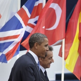 U.S. President Barack Obama (L) walks with French President Nicholas Sarkozy, after Obama's arrival at Espace Riviera for the G20 summit in Cannes, France, November 3, 2011.