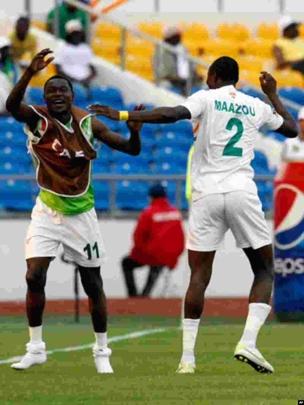 Niger's Moussa celebrates his goal against Tunisia with Allagui during their African Cup of Nations soccer match in Libreville