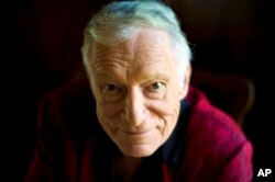 FILE - American magazine publisher, founder and Chief Creative Officer of Playboy Enterprises, Hugh Hefner at his home at the Playboy Mansion in Beverly Hills, Calif., Oct. 13, 2011. Hefner died Thursday at the age of 91.