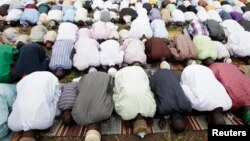 Muslims offered their prayers during a religious holiday.