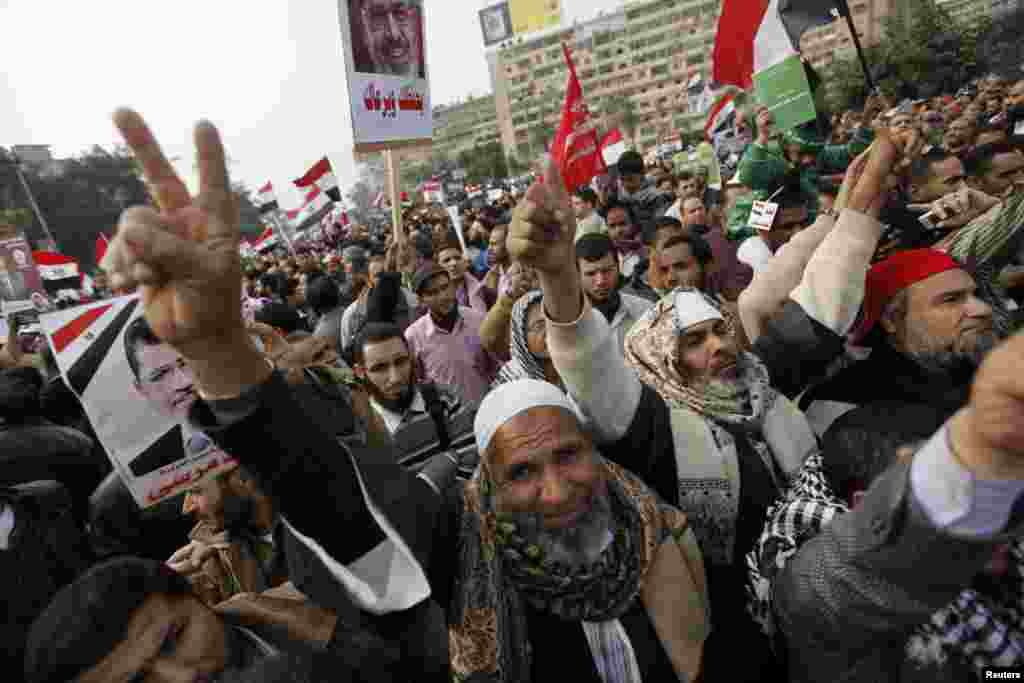 Supporters of Egyptian President Mohamed Mursi and members of the Muslim Brotherhood chant pro-Mursi slogans during a rally in Rabaa El Adaweya Mosque square in Cairo December 14, 2012.