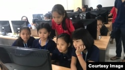 "The ""Cambodia Identity Product"" girls team a computer at during a 12-weekend training at the Cambodia-Korea Cooperation Center. (Courtesy of Technovation Cambodia)"