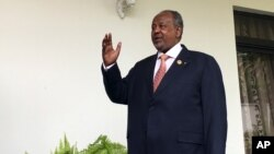 FILE - Djibouti's president, Ismail Omar Guelleh, arrives for a Reuters interview at his home in Ethiopia's capital, Addis Ababa, Jan. 30, 2016.