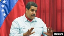 Venezuela's President Nicolas Maduro speaks during a meeting at Miraflores Palace in Caracas, March 26, 2015.