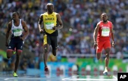 Jamaica's Usain Bolt, center, Trinidadand Tobago's Richard Thompson, right, and Britain's James Dasaolu compete in a men's 100-meter heat during the athletics competitions of the 2016 Summer Olympics at the Olympic stadium in Rio de Janeiro, Aug.