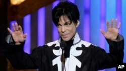 FILE - Prince accepts the award for outstanding male artist at the 38th NAACP Image Awards in this March 2, 2007 file photo, in Los Angeles.
