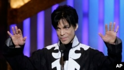 FILE - Prince accepts the award for outstanding male artist at the 38th NAACP Image Awards in Los Angeles, March 2, 2007.