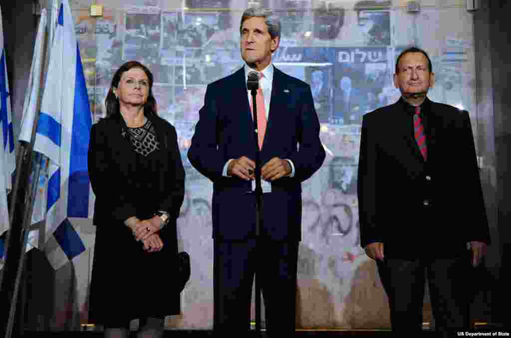 U.S. Secretary of State John Kerry, flanked by Yitzhak Rabin's daughter Dalia and Tel Aviv Mayor Ron Huldai, speaks after laying a wreath at the site where the former Israeli Prime Minister was assassinated in 1995, during a stop in Tel Aviv, Israel, on N