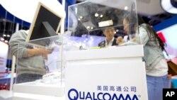 高通公司在北京全球移動互聯網大會上的展位。高通今年7月證實,由於中國監管機構未能批准,該公司已經放棄對荷蘭同行恩智浦的收購。