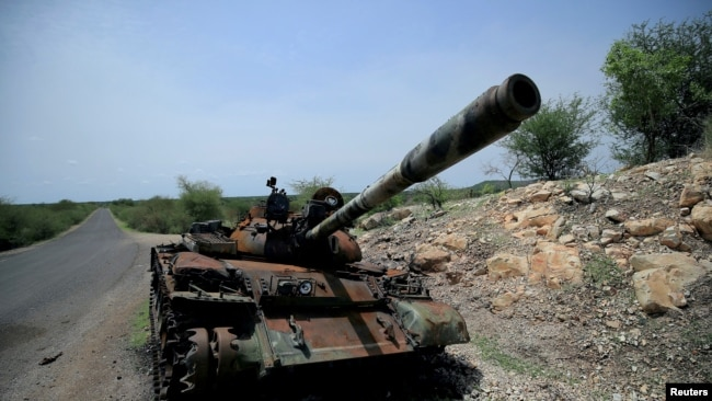FILE - A tank damaged during the fighting between Ethiopia's National Defense Force (ENDF) and Tigray Special Forces stands on the outskirts of Humera town in Ethiopia July 1, 2021.