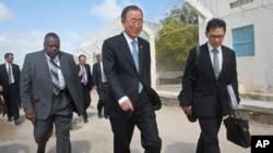 U.N. Secretary-General Ban Ki-moon, center, walks inside the heavily-protected airport complex during a visit to Mogadishu, Somalia, Oct. 29, 2014.