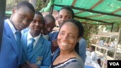 FILE: Jesesi Mungoshi, wife of renowned writer Charles Mungoshi, with students visiting the Zimbabwe International Book Fair. (Photo/Arthur Chigoriwa)