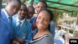 Jesesi Mungoshi, wife of renowned writer Charles Mungoshi, with students visiting the Book Fair. (Photo/Arthur Chigoriwa)