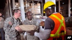 FILE - American soldiers sort through Ebola virus protection equipment to be used in Ebola clinics across the country in Monrovia, Liberia, Nov. 26, 2014.