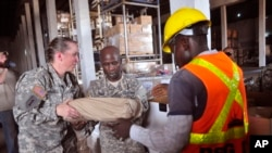 American soldiers sort through Ebola virus protection equipment to be used in Ebola clinics across the country in Monrovia, Liberia. (File photo)