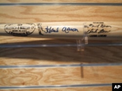 Master copies of the company's more famous bats are kept in a special vault. This slugger is signed by baseball great Hank Aaron.