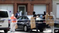 比利時警方在布魯塞爾米蘭比克區搜查一所房屋 (2017年6月21日)