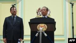 PM Malaysia Muhyiddin Yassin, mengumumkan susunan anggota kabinet barunya di kantor Perdana Menteri Malaysia di Putrajaya, Malaysia, 9 Maret 2020. (Photo by Mohd RASFAN / AFP)