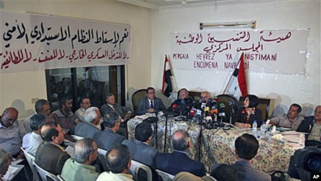 Syrian opposition members attend a Syrian opposition meeting in the Halboun area, near the capital Damascus, Syria, October 6, 2011.