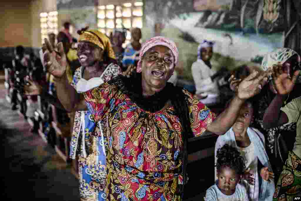 A worshiper prays and sings during a protestant Christmas cult in the Baptist Community of the Congo River in Loma, near Mbanza-Ngungu, Democratic Republic of Congo during the Christian holiday of Christmas.