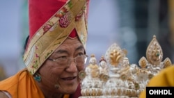 Sakya Trizin presenting offerings during the Long Life Offering Ceremony for the Dalai Lama