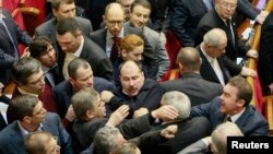 Ukrainian deputies clash in the parliament in Kyiv, Jan. 16, 2014.