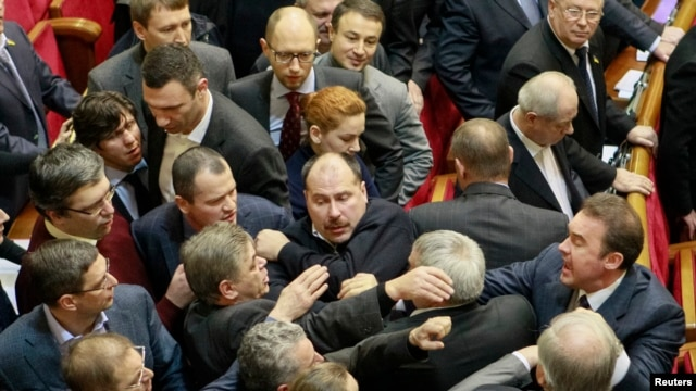 Ukrainian deputies clash in the parliament in Kyiv, Jan. 16, 2014.