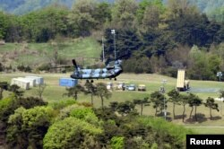 FILE - A Terminal High Altitude Area Defense (THAAD) interceptor (right) is seen in Seongju, South Korea, April 26, 2017.