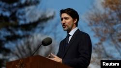 Le Premier ministre du Canada, Justin Trudeau, lors d'une conférence de presse sur le coronavirus à Rideau Cottage, Ottawa, Ontario, Canada, 13 mars 2020. (Reuters/Blair Gable)