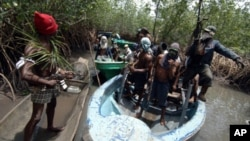 FILE - Militants from Nigeria's Delta region.