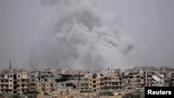 Smoke rises from Raqqa, Syria, July 28, 2017.