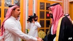 FILE - Photo released by Saudi Press Agency, SPA, shows Saudi Crown Prince Mohammed bin Salman (R) shaking the hand of Salah Khashoggi, son of Jamal Khashoggi, in Riyadh, Saudi Arabia, Oct. 23, 2018.