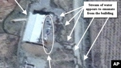 This April 9, 2012 photo provided by the Institute for Science and International Security, ISIS shows suspected cleanup activities at a building alleged to contain a high explosive chamber used for nuclear weapon related tests in the Parchin military comp