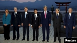 From left, E.U. High Representative for Foreign Affairs Federica Mogherini, and foreign ministers from Canada, Stephane Dion; Britain, Philip Hammond; Japan, Fumio Kishida, U.S. Secretary of State John Kerry; Italy, Paolo Gentiloni, and France, Jean-Marc Ayrault at the Itsukushima Shrine, Miyajima Island, Japan, April 10, 2016.