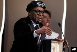 "Director Spike Lee speaks after winning the Grand Prix award for the film ""BlacKkKlansman"" during the closing ceremony of the 71st international film festival, Cannes, southern France, May 19, 2018."