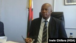 Ministers Joseph Made (L) and Patrick Chinamasa (R)