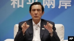 Taiwan's President Ma Ying-jeou discusses his campaign platform for the upcoming presidential elections regarding cross-strait relations during a press conference at the Presidential Office Taipei, Taiwan, October 17, 2011.