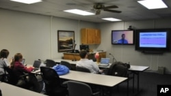 Medical students in the small town of Salina - population 50,000 - listen to a remote lecture. It's part of a Kansas University program designed to keep doctors in rural areas of the United States.