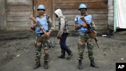 FILE - Two MONUSCO soldiers are seen standing guard in Goma, DRC.