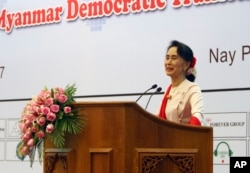 FILE - Myanmar's State Counsellor Aung San Suu Kyi delivers an opening speech during the Forum on Myanmar Democratic Transition at Myanmar International Convention Center in Naypyitaw, Myanmar, Aug 11, 2017.