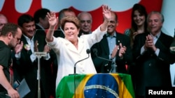Brazil's President Dilma Rousseff reacts during news conference to the election results, in Brasilia Oct. 26, 2014. (REUTERS/Ueslei Marcelino)