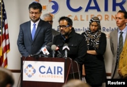 Farhan Khan, center, brother-in-law of San Bernardino shooting suspect Syed Farook, speaks at the Council on American-Islamic Relations during a news conference in Anaheim, California, Dec. 2, 2015.