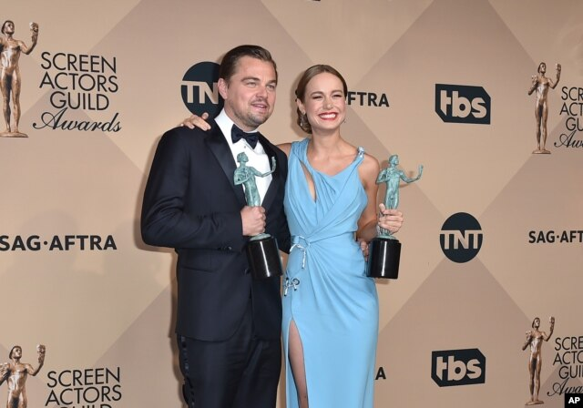 """Leonardo DiCaprio, left, winner of the award for outstanding male actor in a leading role for """"The Revenant"""" and Brie Larson winner of the award for outstanding female actress in a leading role for """"Room"""", pose in the press room at the 22nd annual Screen Actors Guild Awards at the Shrine Auditorium & Expo Hall, Jan. 30, 2016, in Los Angeles."""