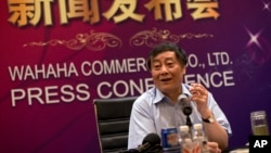 FILE - In this July 17, 2013 photo, Zong Qinghou, chairman of food and beverage giant Wahaha Group, smokes as he speaks to the journalists during a news conference in Beijing, China.