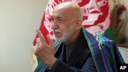 FILE - Former Afghan President Hamid Karzai speaks in Kabul, Afghanistan, April 17, 2017.