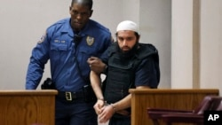 FILE - Ahmad Khan Rahimi, the man linked to planting two bombs in New York and New Jersey, is led into court in Elizabeth, New Jersey, Dec. 20, 2016.
