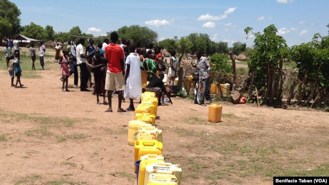 South Sudanese wait to fill a long line of jerry cans at a borehole in the Ocea sector of Rhino refugee resettlement camp in Uganda.