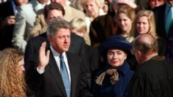 Bill Clinton takes the oath of office from Chief Justice William Rehnquist at the Capitol on January 20, 1993. Hillary Rodham Clinton and their daughter Chelsea are at his side and behind him is Vice President Al Gore.